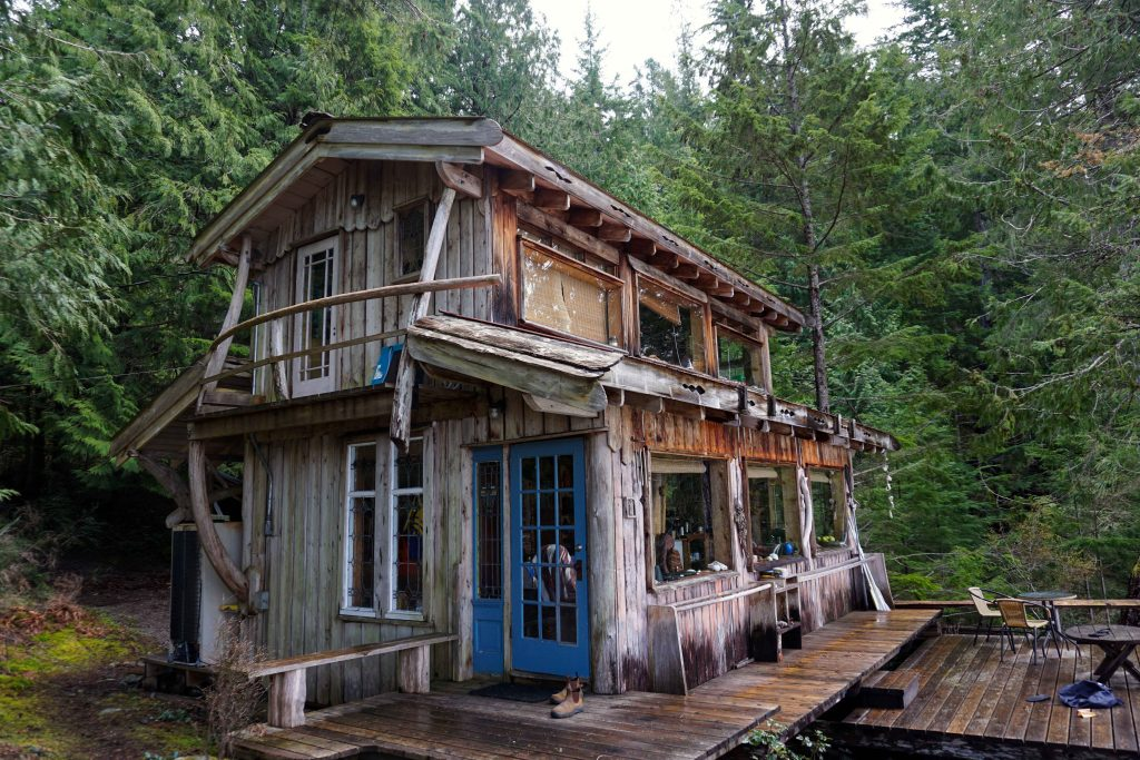 Old wood cabin surrounded by trees