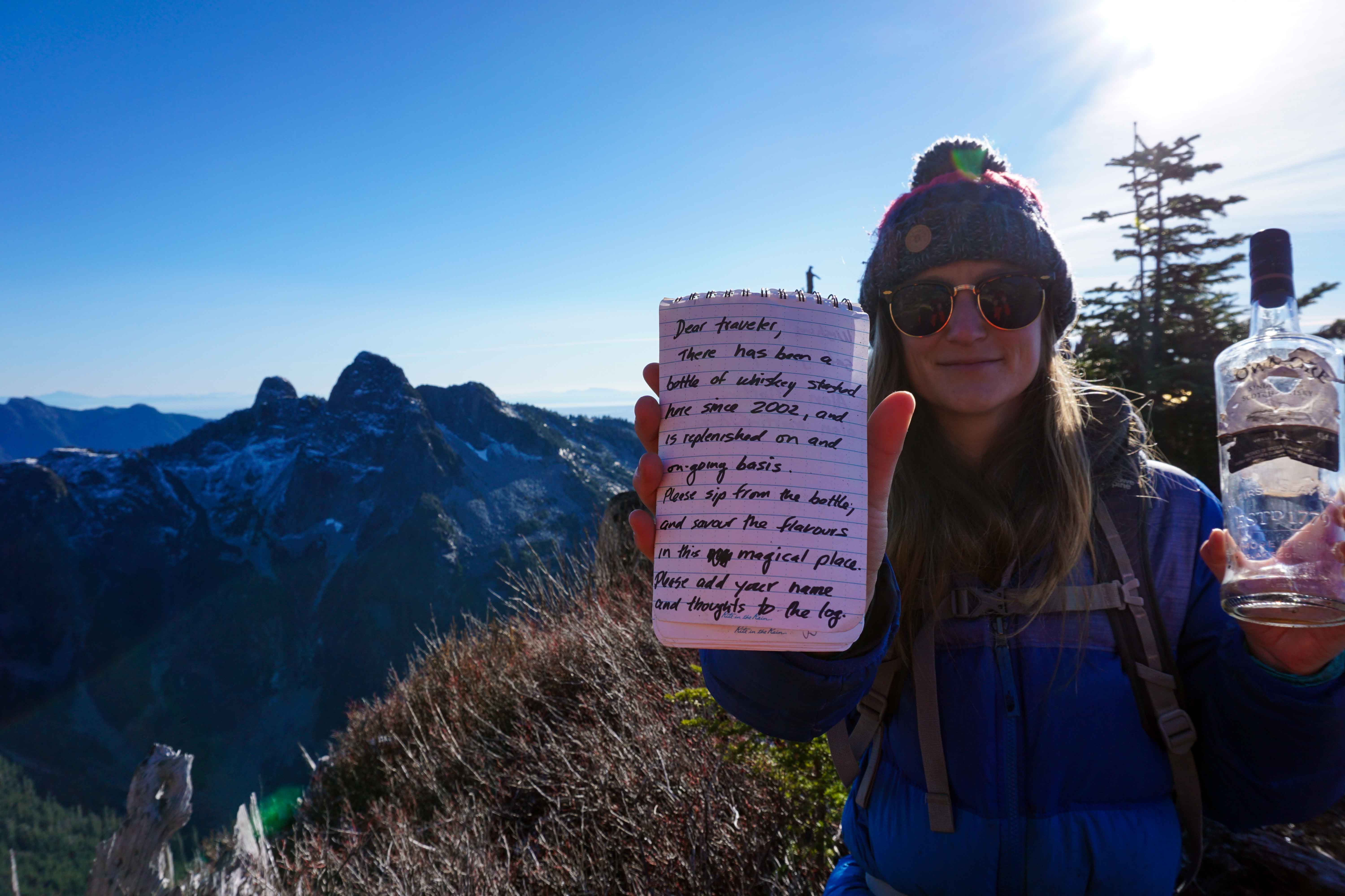 Whiskey stash and note on top of Mount Harvey