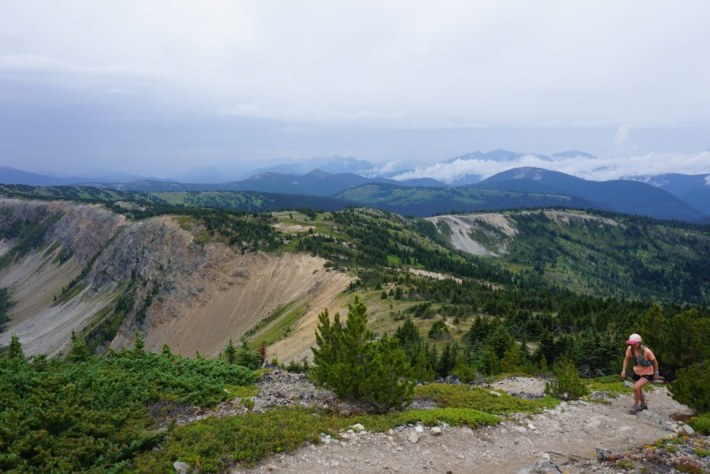 Woman walks up mountain ridge