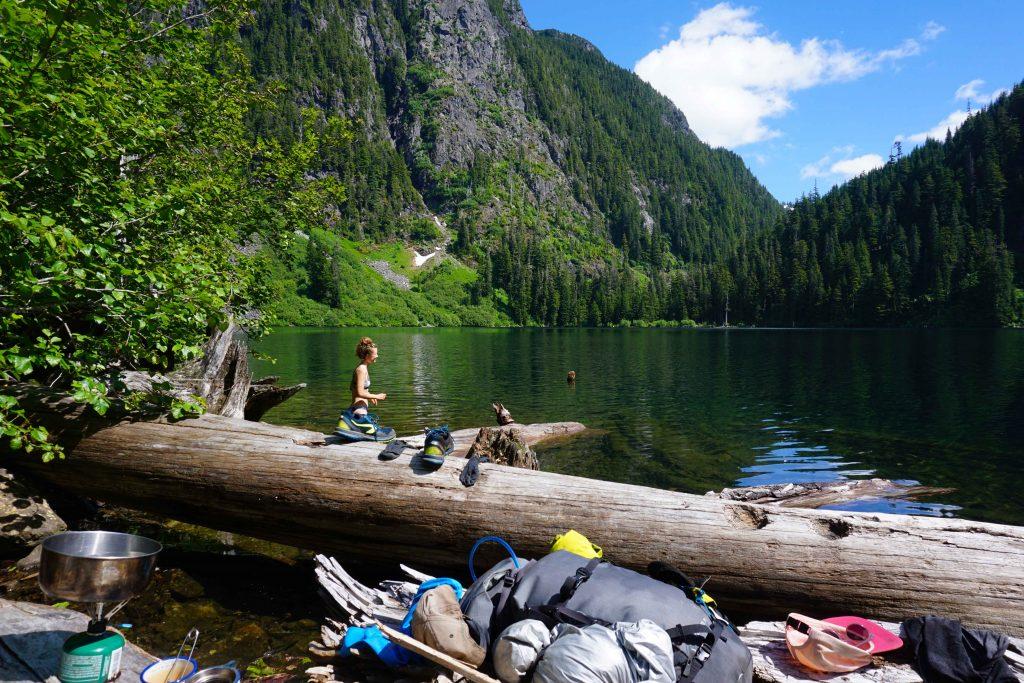 Woman swims in alpine lake
