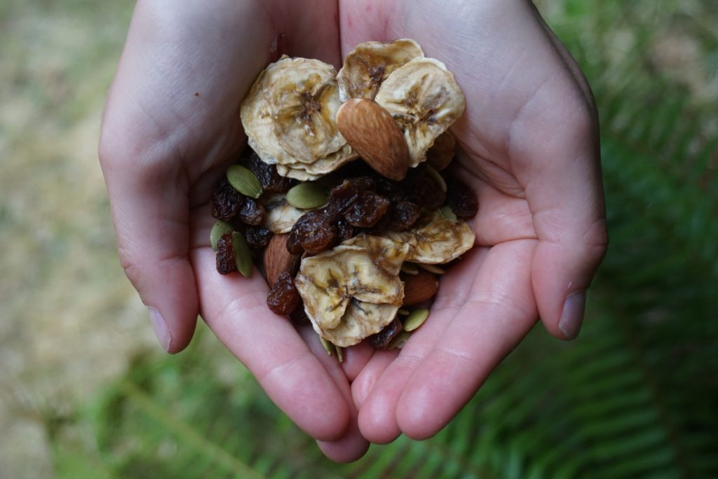 Trail mix held in cupped hands